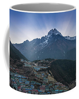 Coffee Mug featuring the photograph Namche And Thamserku Peak Morning Sunrays by Mike Reid