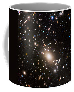 Coffee Mug featuring the photograph Nasa's Hubble Looks To The Final Frontier by Nasa