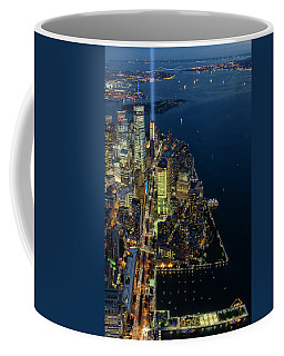 Coffee Mug featuring the photograph New York City Remembers 911 by Susan Candelario