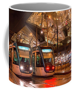 Night View Of Two Trams At Glories Station  Coffee Mug