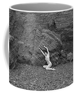 Nude Woman Pulling Shape By Rocks Coffee Mug