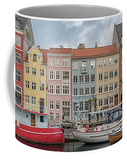 Coffee Mug featuring the photograph Nyhavn Waterfront In Copenhagen by Antony McAulay
