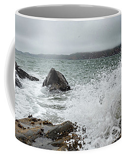 Coffee Mug featuring the photograph Ocean Water Crashing Againt Rocks With Cloudy Skies by PorqueNo Studios