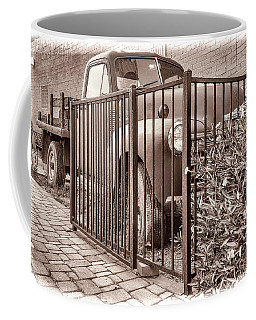 Coffee Mug featuring the photograph Ol' Chevy Castrated by Charles Ables