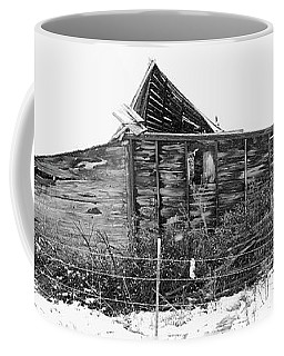 Old Barn In Snow Storm Coffee Mug