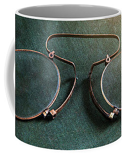 Coffee Mug featuring the photograph Old Green Notebook And Old Binoculars by Jaroslaw Blaminsky