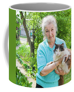 Old Lady With Cat Coffee Mug by Irina Afonskaya