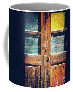 Coffee Mug featuring the photograph Old Rotten Door by Silvia Ganora
