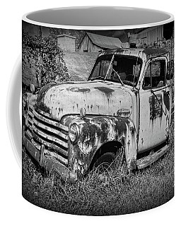 Coffee Mug featuring the photograph Old Rusty Chevy In Black And White by Paul Ward