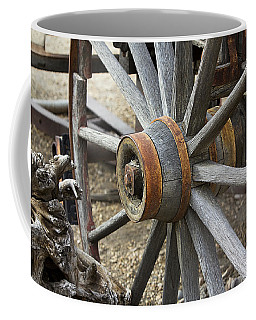 Coffee Mug featuring the photograph Old Waagon Wheel by Phyllis Denton