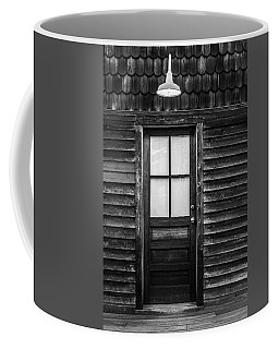 Old Wood Door And Light Black And White Coffee Mug by Terry DeLuco