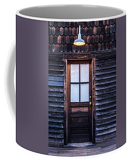 Old Wood Door And Light Coffee Mug by Terry DeLuco