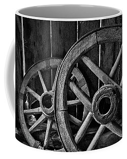 Coffee Mug featuring the photograph Old Wooden Wheels by Stuart Litoff
