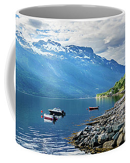 Coffee Mug featuring the photograph On The Beach Of Sorfjorden by Dmytro Korol