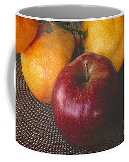 Coffee Mug featuring the photograph One Apple Three Oranges by Ella Kaye Dickey