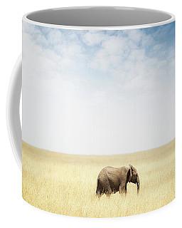 One Elephant Walking In Grass In Africa Coffee Mug