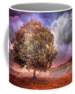 Coffee Mug featuring the photograph One Tree In The Meadow by Debra and Dave Vanderlaan