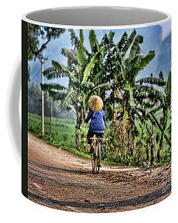 One Vietnamese Woman Bike  Coffee Mug by Chuck Kuhn