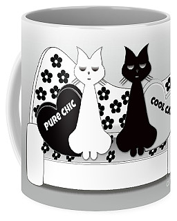 Opposites Attract - Black And White Cats On The Sofa Coffee Mug