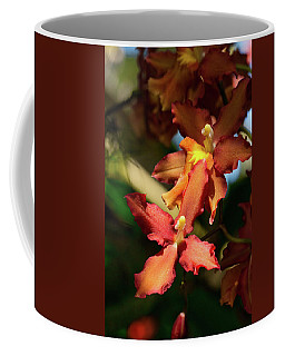 Coffee Mug featuring the photograph Orange Leap by Richard Goldman