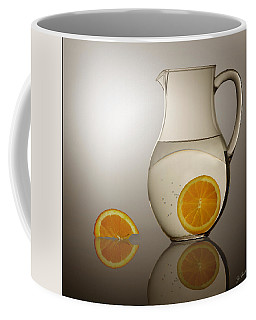 Coffee Mug featuring the photograph Oranges And Water Pitcher by Joe Bonita