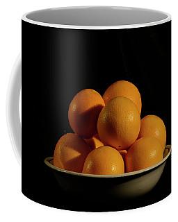 Coffee Mug featuring the photograph Oranges by Angie Tirado