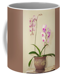 Orchids On Sideboard Coffee Mug