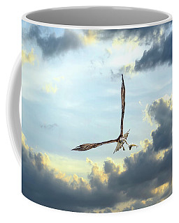 Osprey Flying In Clouds At Sunset With Fish In Talons Coffee Mug