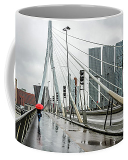 Coffee Mug featuring the photograph Over The Erasmus Bridge In Rotterdam With Red Umbrella by RicardMN Photography