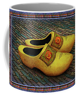 Coffee Mug featuring the photograph Oversized Dutch Clogs by Hanny Heim
