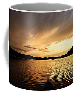 Coffee Mug featuring the photograph Paddling At Sunset On Kekekabic Lake by Larry Ricker