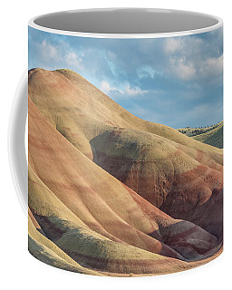 Coffee Mug featuring the photograph Painted Hill And Clouds by Greg Nyquist
