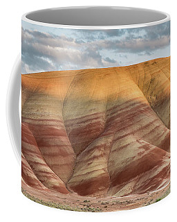 Coffee Mug featuring the photograph Painted Hill At Last Light by Greg Nyquist