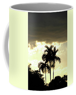 Palm Tree And Storm Clouds Coffee Mug