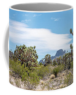 Coffee Mug featuring the photograph Panoramic View Of Desert Landscape With Joshua Tree And Mountain by PorqueNo Studios