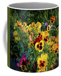 Coffee Mug featuring the photograph Pansies by John Brink