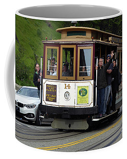 Passenger Waves From A Cable Car Coffee Mug