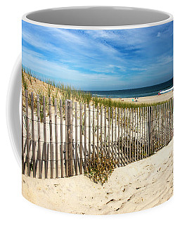 Coffee Mug featuring the photograph Past The Dune Fence by John Rizzuto