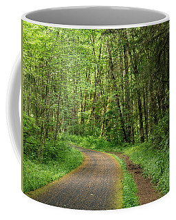 Coffee Mug featuring the photograph Path Through The Woods by Jean Noren