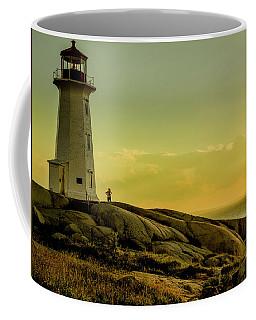Peggys Cove Lighthouse At Sunset  Coffee Mug by Ken Morris