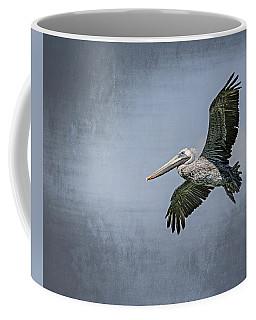 Coffee Mug featuring the photograph Pelican Flight by Carolyn Marshall