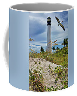 Pelican Flying Over Cape Florida Lighthouse Coffee Mug