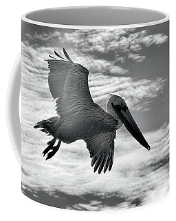 Pelican In Flight Coffee Mug by AJ Schibig