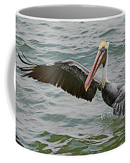 Coffee Mug featuring the photograph Pelican Take Off by Jimmie Bartlett