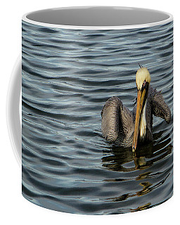 Coffee Mug featuring the photograph Pelican Wing In A  Twist by Jean Noren