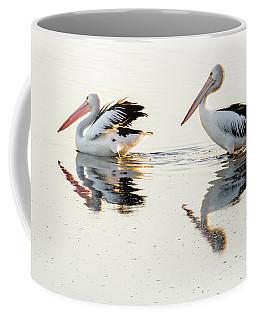 Pelicans At Dusk Coffee Mug by Werner Padarin