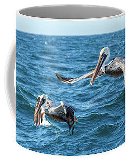 Coffee Mug featuring the photograph Pelicans Flying by Robert Bales