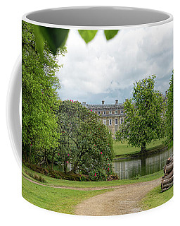 Coffee Mug featuring the photograph Petworth House On Lake by Michael Hope