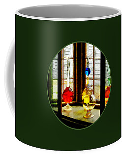 Coffee Mug featuring the photograph Pharmacist - Colorful Bottles In Drug Store Window by Susan Savad