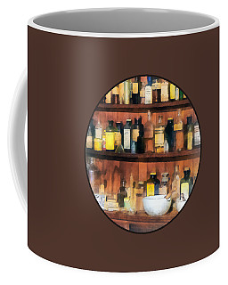 Coffee Mug featuring the photograph Pharmacist - Mortar Pestles And Medicine Bottles by Susan Savad